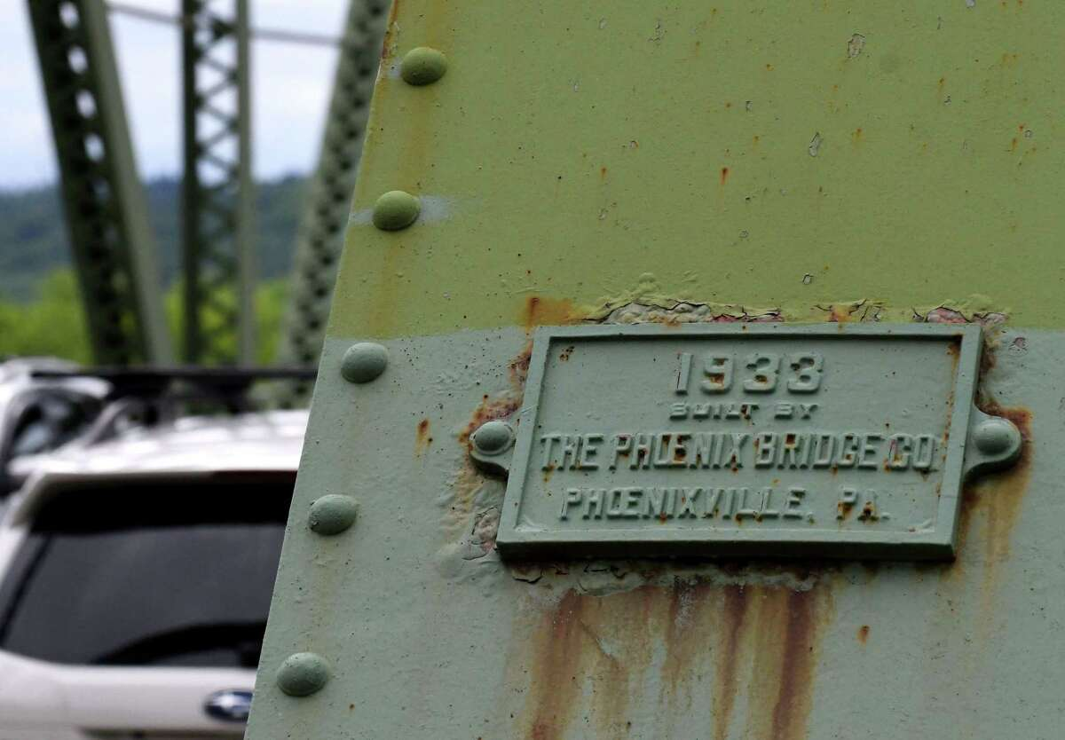 A plaque on the Troy-Menands Bridge denotes its year and builder on Thursday, June 13, 2019, in Troy, N.Y. A study of whether to replace the aging structure is included in the latest five-year Transportation Improvement Program approved by the Capital District Transportation Committee. (Will Waldron/Times Union)