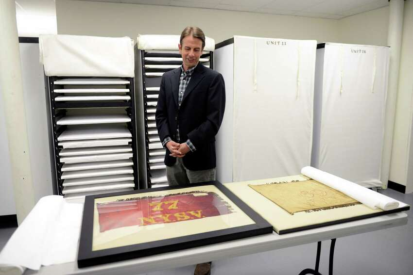 Christopher Morton, curator and flag expert, poses for a portrait in the flag storage room at the New York State Military Museum on Tuesday, June 11, 2019, in Saratoga Springs, N.Y. The museum has the largest government-owned state battle flag collection in the country and the largest collection of Civil War flags in the world. (Catherine Rafferty/Times Union)