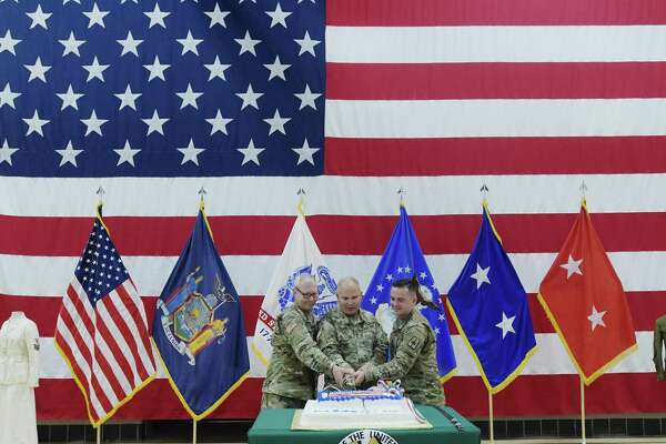 Master Sgt. John Batza, left, Major General Raymond Shields, center, and Sgt. Tyler Center, take part in a ceremonial cutting of the cake at an event at the New York State Division of Military and Naval Affairs Headquarters to celebrate the 243rd birthday of the United States Army last year in Latham, N.Y.