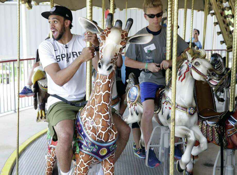 Spurs guard Derrick White gets on the tallest seat on the merry-go-round as he visits Morgan's Wonderland with a group of special needs children on June 12, 2019. Photo: Tom Reel, Staff / Staff Photographer / 2019 SAN ANTONIO EXPRESS-NEWS