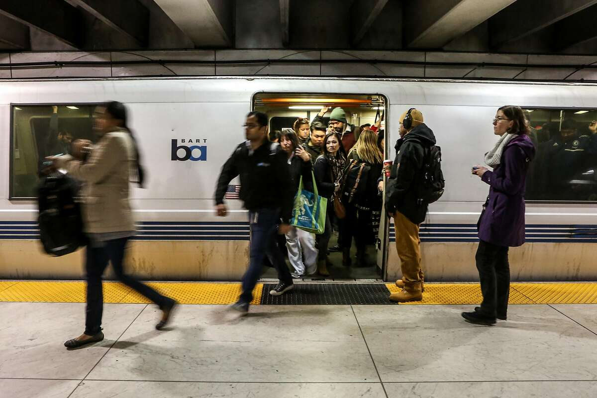 Passengers exit a crowded westbound train from Oakland at the Embarcadero boards an eastbound train during the major delays after a train locked up in West Oakland on Friday, January 2 2017.