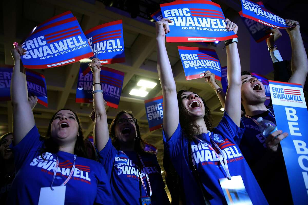 SAN FRANCISCO, CALIFORNIA - JUNE 01: Supporters of Democratic presidential candidate U.S. Rep. Eric Swalwell (D-CA) hold signs as he speaks during the California Democrats 2019 State Convention at the Moscone Center on June 01, 2019 in San Francisco, California. Several Democratic presidential candidates are speaking at the California Democratic Convention that runs through Sunday. (Photo by Justin Sullivan/Getty Images)