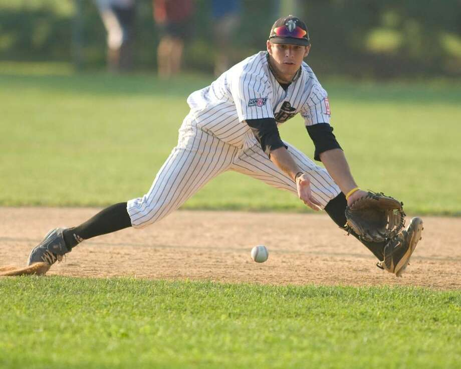 Westerners' third baseman Brian Kownacki goes to his left to glove a ball in the hole against North Adams Wednesday night at Rogers Park. Photo: Barry Horn / The News-Times Freelance