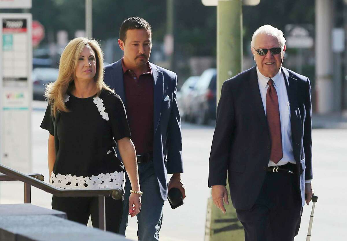 """The Texas State Securities Board accused convicted felon Brian Alfaro, center, and his wife, Kristi Alfaro, of contacting potential investors for a """"fraudulent wildlife breeding and development program."""" The Alfaros are seen with attorney Dean Greer heading to U.S. Bankruptcy Court in 2019."""