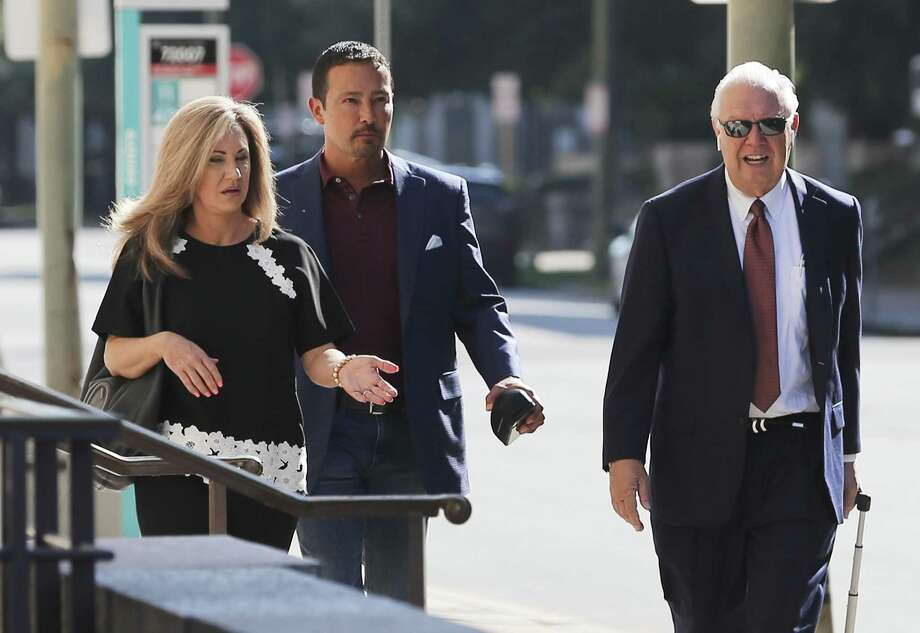 Brian and Kristi Alfaro along with their attorney Dean Greer make their way to their bankruptcy court hearing at Hipolito Garcia U.S. Courthouse on Thursday, June 13, 2019. Photo: Kin Man Hui /Staff Photographer / ©2019 San Antonio Express-News