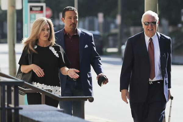 Brian and Kristi Alfaro along with their attorney Dean Greer are photographed outside of U.S. Bankruptcy Court Thursday. A court-appointed receiver filed court motions in an effort to collect monies on an $8 million judgment against Brian Alfaro, an embattled oil and gas businessman.