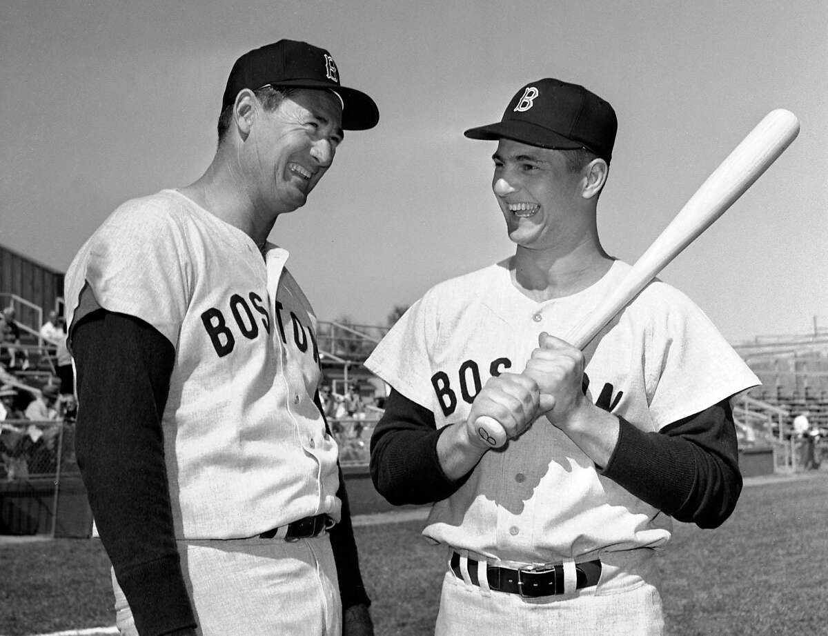 """** FILE ** Ted Williams, left, and Carl Yastrzemski are shown at the Boston Red Sox spring training camp in Scottsdale, Ariz., in this March 1, 1963 file photo. Williams, the Red Sox revered and sometimes reviled """"Splendid Splinter'' and baseball's last 400 hitter, died Friday, July 5, 2002 at age 83. Williams, who suffered a series of strokes and congestive heart failure in recent years, was taken Friday to Citrus County Memorial Hospital in Crystal River, Fla., where he was pronounced dead of cardiacarrest at 8:49 a.m., said hospital spokeswoman Rebecca Martin. (AP Photo/File)"""
