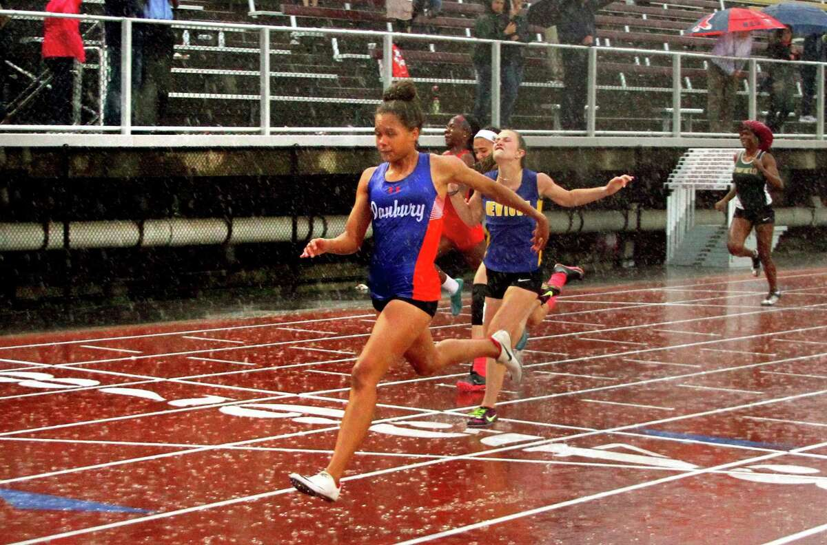Danbury's Alanna Smith crosses the finish for first place in the 100-meter dash final during the Class LL championship on May 29.
