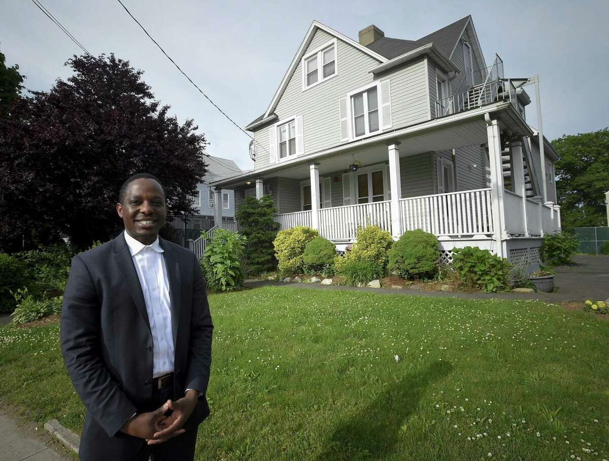 Eugene Osagie is photographed on June 7, 2019 in front of a Washington Boulevard house in Stamford, Conn. he called home as a teenager. The group home, Domus House, closed last month. The center, which provided a shelter and food to homeless teenage men, like Osagie, had been in operation for over 40 years. Osagie lived at the house for seven years, between the ages of 14 and 21, and said Domus House saved his life.