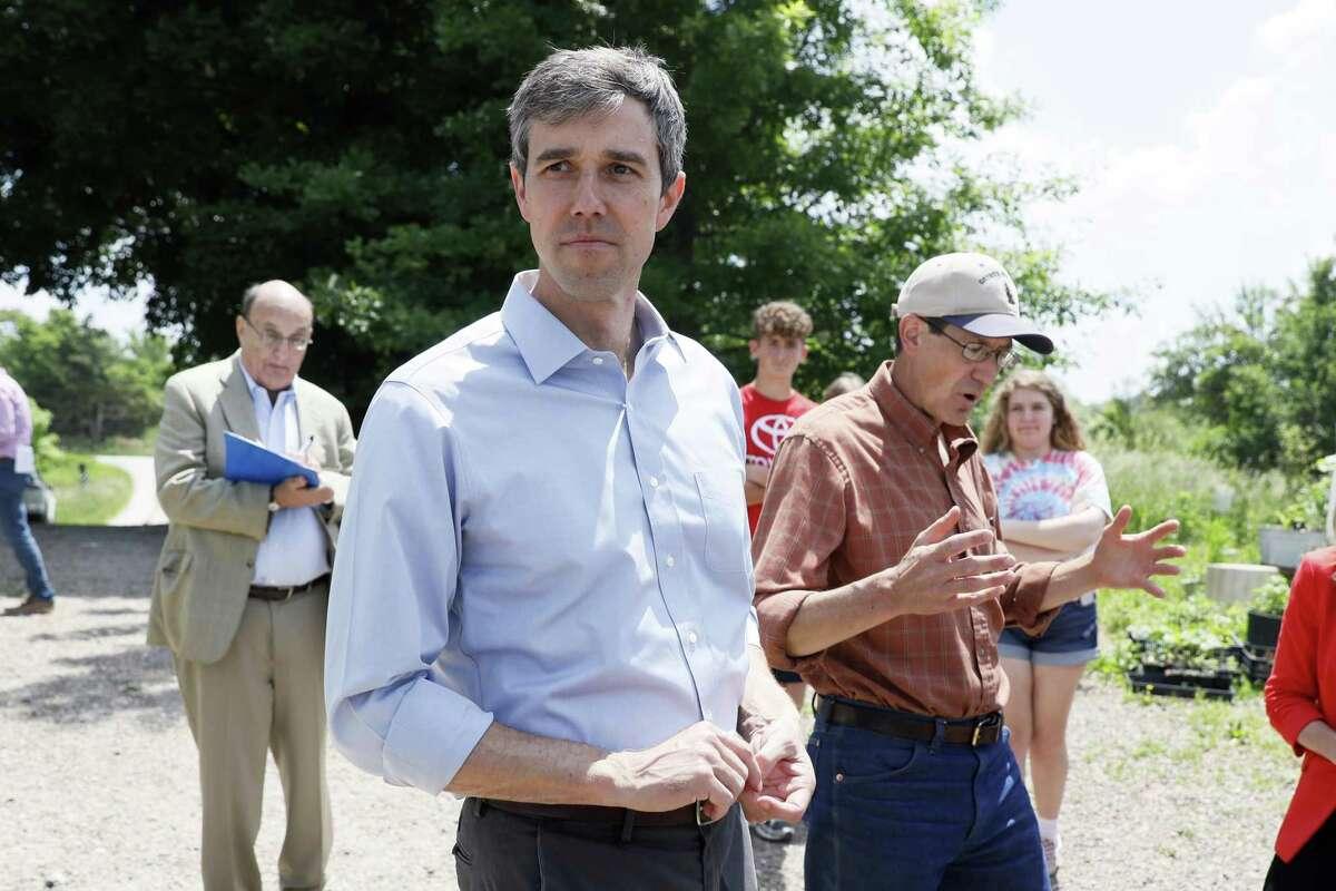 Democratic presidential candidate Beto O'Rourke tours the Coyote Run Farm with farmer Matt Russell, right, Friday, June 7, 2019, in Lacona, Iowa. (AP Photo/Charlie Neibergall)