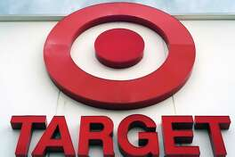 FILE - This May 3, 2017, file photo shows a Target store in Omaha, Neb. Target is offering same-day delivery on thousands of items $9.99 per order through a startup it purchased nearly two years ago. Until now, Target shoppers looking to receive same-day delivery through Shipt had to go to the startup's website and pay $99 for an annual membership or $14 for a monthly membership. This week, Target incorporated the Shipt feature on its website. (AP Photo/Nati Harnik, File)