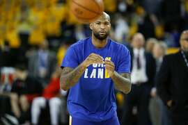 Golden State Warriors' DeMarcus Cousins goes through his pregame warmup for game 6 of the NBA Finals between the Golden State Warriors and the Toronto Raptors at Oracle Arena on Thursday, June 13, 2019 in Oakland, Calif.