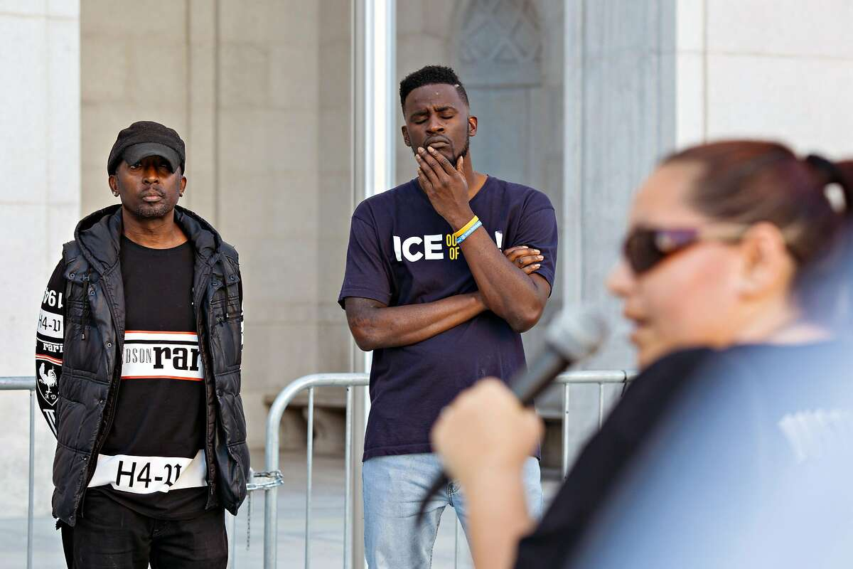 LOS ANGELES, CA - JUNE 12, 2019: Quintus Moore (left) participates in a weekly protest outside the L.A. Hall of Justice, organized by LA Black Lives Matter, and is an activist for laws that would make it more difficult for law enforcement officers to resort to deadly force. Him along with other activists listen to another activist talk about her personal story.