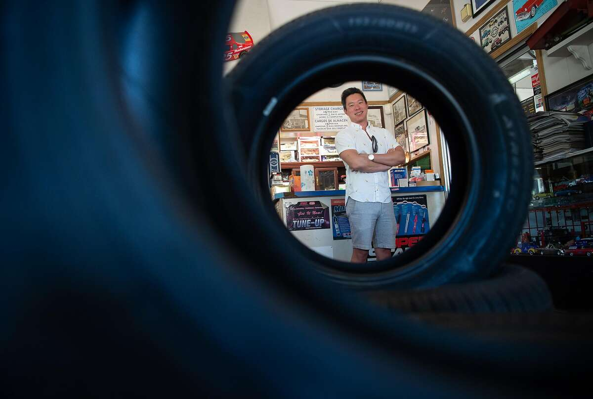 John Sun stands for a photo in Mike's Alignment located on his mixed-use property in Sonoma, California on May 31, 2019. Sun purchased the property, which has a brake and tuxedo shop on it, to take advantage of a new tax-saving opportunity Congress created in the 2017 tax law.
