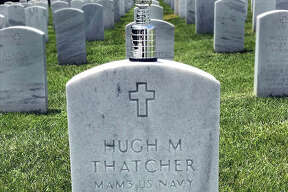 "A miniature Stanley Cup replica sits atop the gravestone of Hugh ""Hoot"" Thatcher, the father of East Alton Ice Arena manager Larry Thatcher, who along with lifelong friend Dana Emerick have been devoted to the St. Louis Blues and the game of hockey since 1967. Thatcher and Emerick placed the miniature cup Thursday morning at Jefferson Barracks Cemetery."