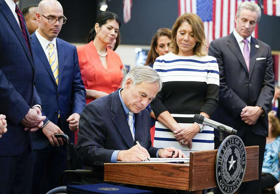 Texas Gov. Greg Abbott signs a Harvey-related measure at Gallery Furniture on Thursday, June 13, 2019 in Houston. Photo: Elizabeth Conley, Staff Photographer