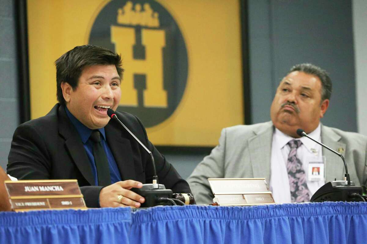 President Ricardo Moreno reads from a prepared text denying faults of the school board as then-Superintendent Rey Madrigal listens during a June meeting. The agenda for Monday's meeting includes discussions about the district's future litigation with the Texas Education Agency over its special accreditation investigation and Madrigal's termination.