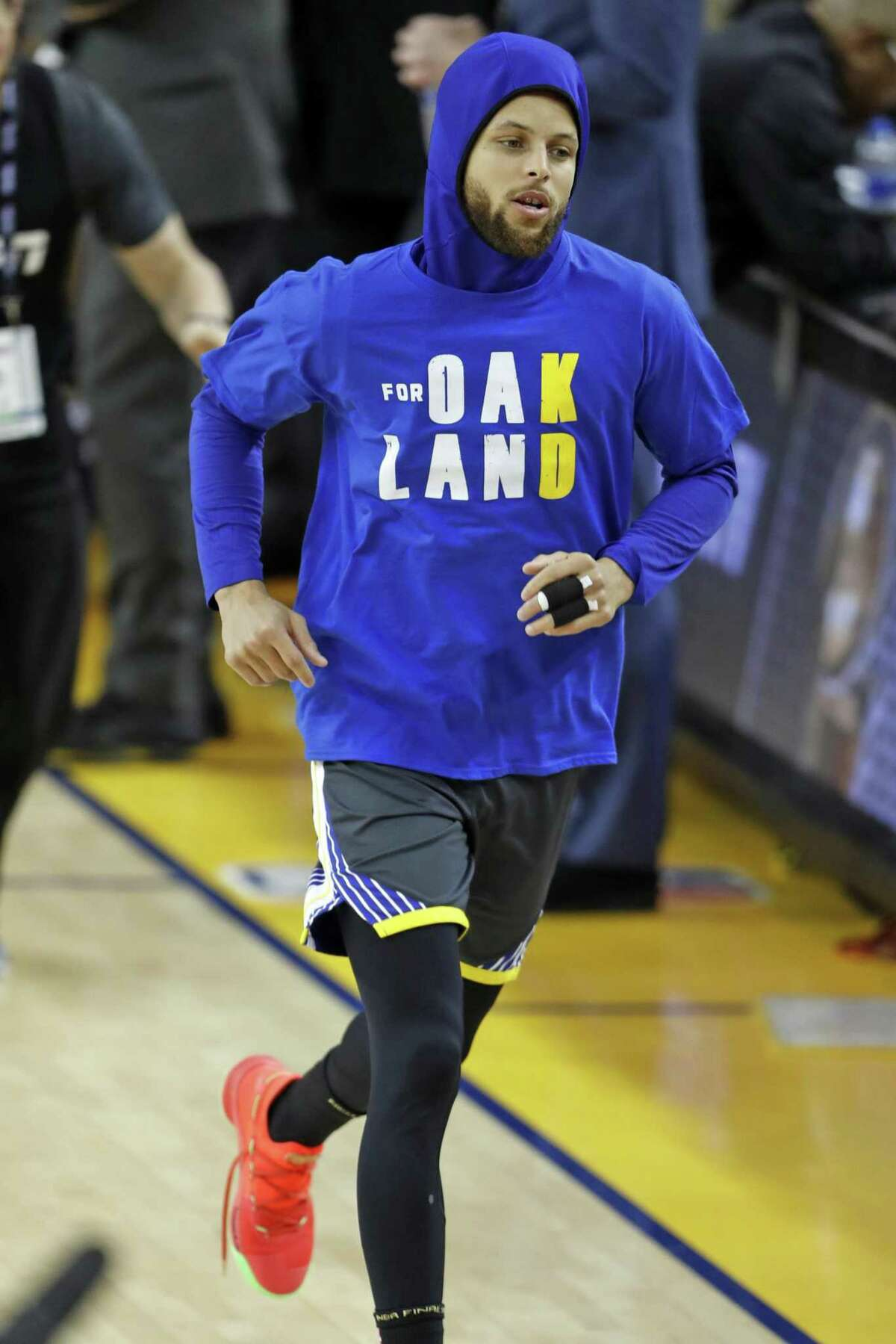 Golden State Warriors' Stephen Curry arrives for warm ups wearing a t-shirt honoring Oakland and Kevin Durant before playing Toronto Raptors in Game 6 of NBA Finals at Oracle Arena in Oakland, Calif., on Thursday, June 13, 2019.