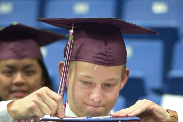 Matthew Evan Canfield makes a last minute adjustment to Veronica Elizabeth Breen's tassel before the Bethel High School Class of 2019 Commencement Ceremony, Thursday June 13, 2019, at the O'Neill Center, Western Connecticut State University, Danbury, Conn.