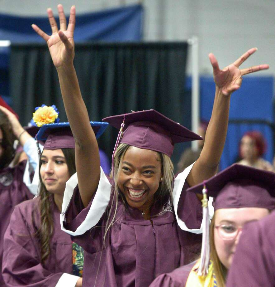 Laedie Mont-Karmell Shaina Felix waves as she walks with her class mates into the Bethel High School Class of 2019 Commencement Ceremony, Thursday June 13, 2019, at the O'Neill Center, Western Connecticut State University, Danbury, Conn. Photo: H John Voorhees III, Hearst Connecticut Media / The News-Times