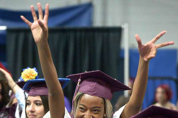 Laedie Mont-Karmell Shaina Felix waves as she walks with her class mates into the Bethel High School Class of 2019 Commencement Ceremony, Thursday June 13, 2019, at the O'Neill Center, Western Connecticut State University, Danbury, Conn.