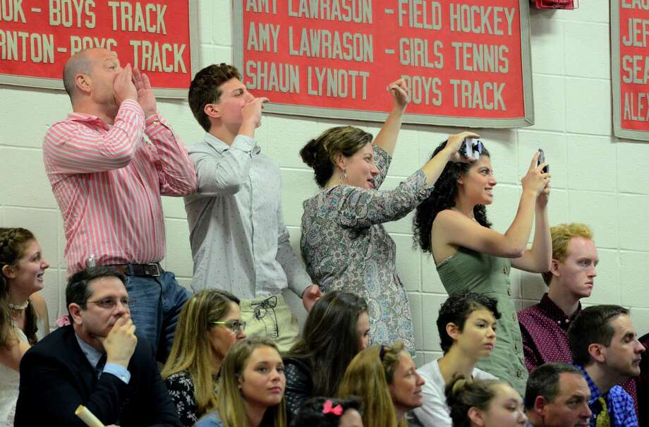 Family members cheer for a graduate during Pomperaug High School's Commencement Ceremony in Southbury, Conn., on Thursday June 13, 2019. Photo: Christian Abraham, Hearst Connecticut Media / Connecticut Post