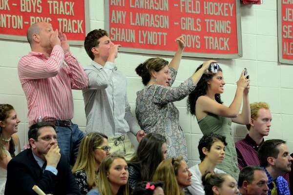 Family members cheer for a graduate during Pomperaug High School's Commencement Ceremony in Southbury, Conn., on Thursday June 13, 2019.