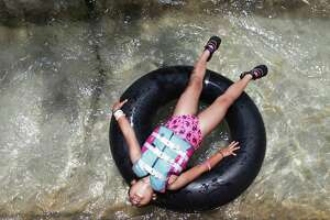 Samya Marcuez, 8, from Fort Worth sprawls out across a tube at Schlitterbahn in New Braunfels, Thursday June 13, 2019. The park features several river rides for patrons to float down. Rebecca Slezak/Staff photographer