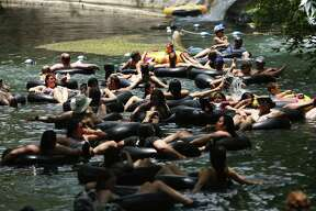 Patrons at Schlitterbahn tube down one of several tube river rides in New Braunfels, Thursday June 13, 2019. Schlitterbahn has 51 different rides. The original section of the park located in its west campus uses water from the Comal River to power its rides. Rebecca Slezak/Staff photographer