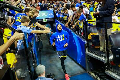 Stephen Curry (30) makes his way into Oracle Arena ahead of Game 6 of the NBA Finals between the Golden State Warriors and the Toronto Raptors in Oakland, California, on Thursday, June 13, 2019.