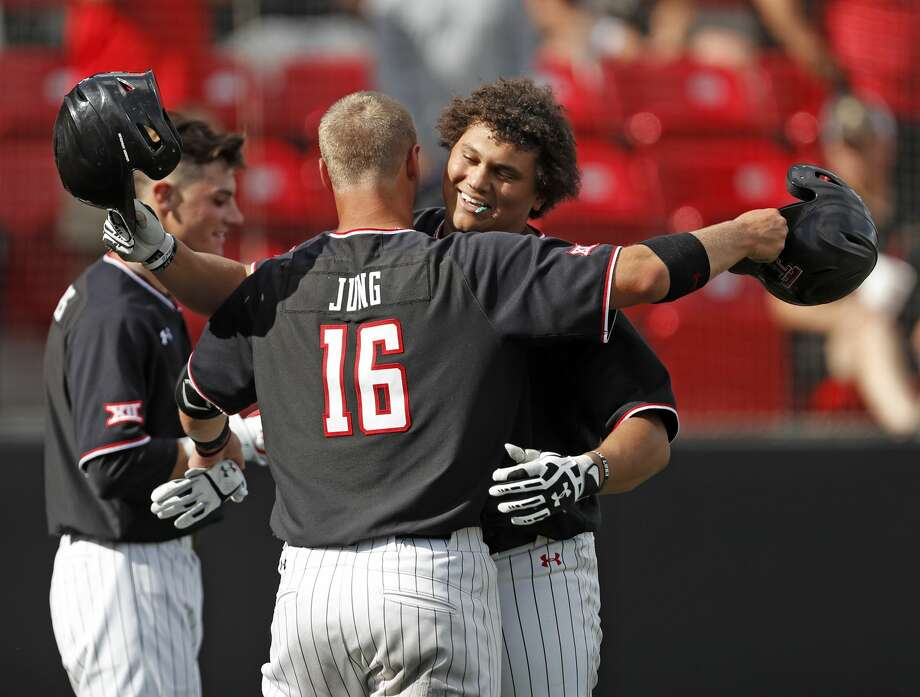 Texas Tech's Josh Jung (16) hugs Cameron Warren after he hit a home run during the NCAA college baseball regional against Army, Friday, May 31, 2019, in Lubbock. Photo: Brad Tollefson/Associated Press
