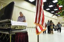Laurel VanDevender pays her respect to Bob Bowers during his visitation at the Robert A. Bowers Civic Center in Port Arthur on Thursday. Photo taken on Thursday, 06/13/19. Ryan Welch/The Enterprise