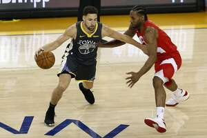 OAKLAND, CALIFORNIA - JUNE 13:  Klay Thompson #11 of the Golden State Warriors is defended by Kawhi Leonard #2 of the Toronto Raptors in the first half during Game Six of the 2019 NBA Finals at ORACLE Arena on June 13, 2019 in Oakland, California. NOTE TO USER: User expressly acknowledges and agrees that, by downloading and or using this photograph, User is consenting to the terms and conditions of the Getty Images License Agreement. (Photo by Lachlan Cunningham/Getty Images)