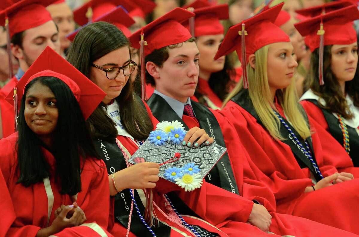 Graduate Catherine Windover fixes her cap during Pomperaug High School's Commencement Ceremony in Southbury, Conn., on Thursday June 13, 2019.