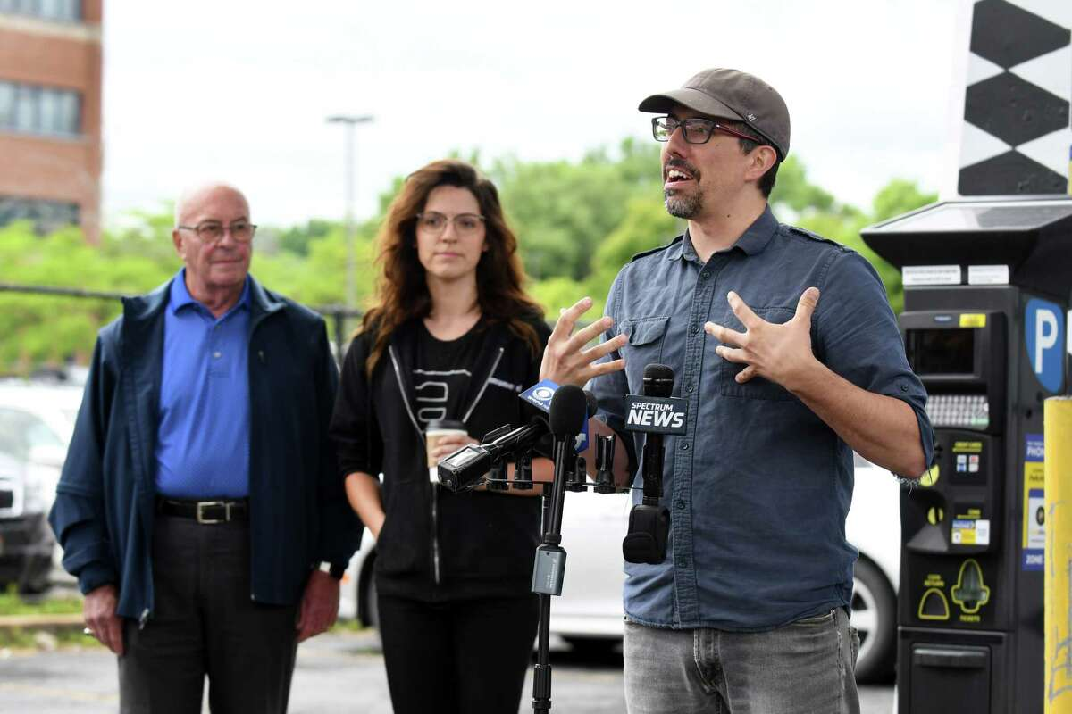 Tony Iadicicco, Director of Albany Center Gallery and Curator of Capital Walls, right, speaks to community partners gathered to announce the upcoming mural projects in downtown Albany on Thursday, June 13, 2019, at the Albany Parking AuthorityOs Quackenbush Lot in Albany, N.Y. (Catherine Rafferty/Times Union)