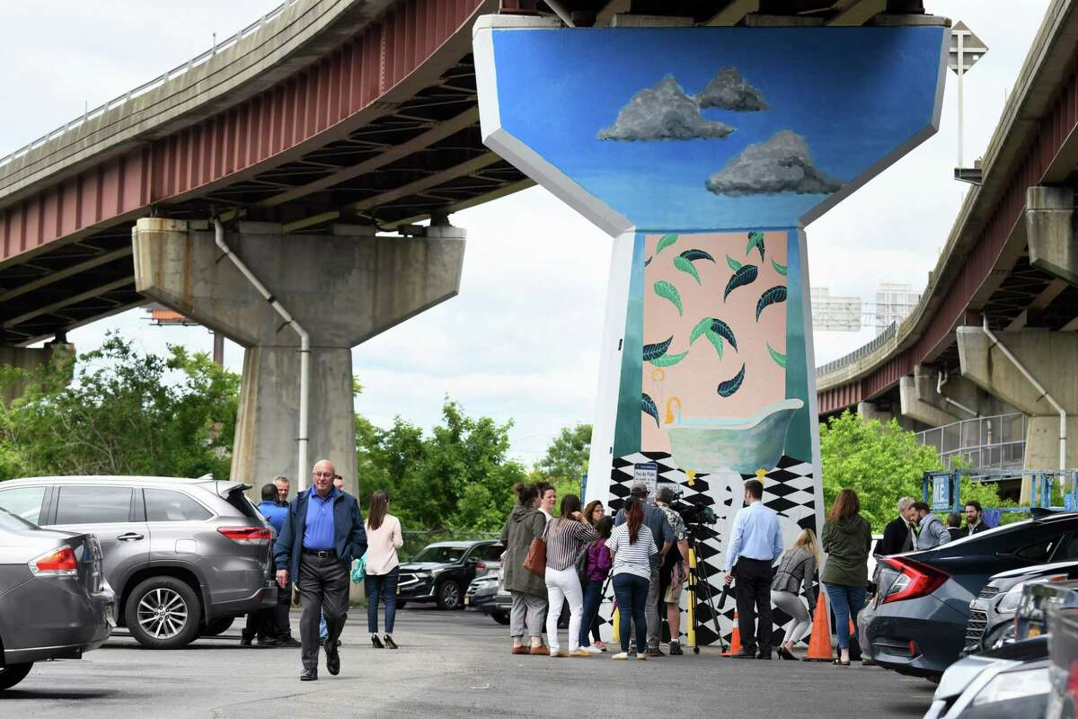 Representatives of the Albany Parking Authority, City of Albany Mayor Kathy Sheehan and community partners gathered to announce the upcoming mural projects in downtown Albany beneath the I-787 off-ramp to Clinton Ave. in front of artist Vanessa Mastronardi's mural on Thursday, June 13, 2019, at the Albany Parking AuthorityOs Quackenbush Lot in Albany, N.Y. Mastronardi began work on the mural on June 10, 2019 and will complete it later this month. (Catherine Rafferty/Times Union)