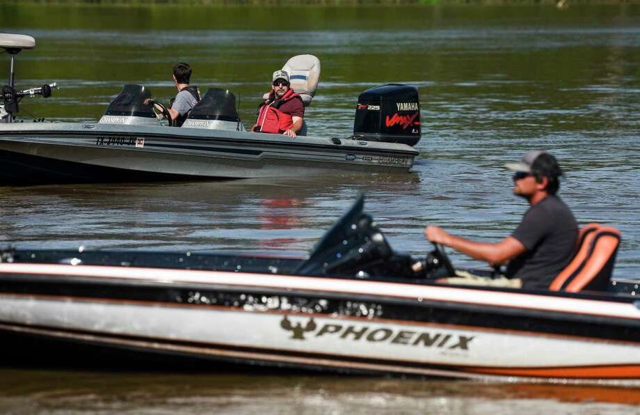 Fishermen lower their boats into the Neches River at the saltwater barrier during a Neches River Bass Association fishing tournament Thursday. Photo taken on Thursday, 06/13/19. Ryan Welch/The Enterprise Photo: Ryan Welch, The Enterprise / © 2019 Beaumont Enterprise