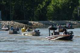 Fisherman take off down the Neches River at the saltwater barrier at the start of a Neches River Bass Association fishing tournament Thursday. Photo taken on Thursday, 06/13/19. Ryan Welch/The Enterprise