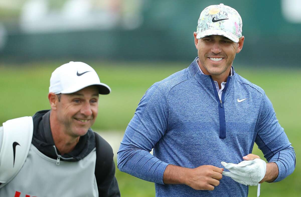 PEBBLE BEACH, CALIFORNIA - JUNE 13: Brooks Koepka of the United States (R) and caddie, Richard Elliott, laugh on the 18th hole during the first round of the 2019 U.S. Open at Pebble Beach Golf Links on June 13, 2019 in Pebble Beach, California. (Photo by Warren Little/Getty Images)