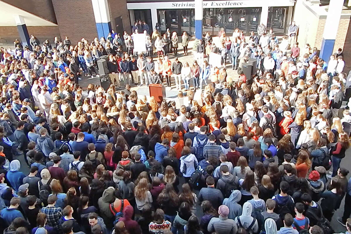 Students and staff gathered outside the main entrance of Wilton High School on March 14, for a 17-minute walkout in honor of the victims of the Parkland shooting.-Kendra Baker photo