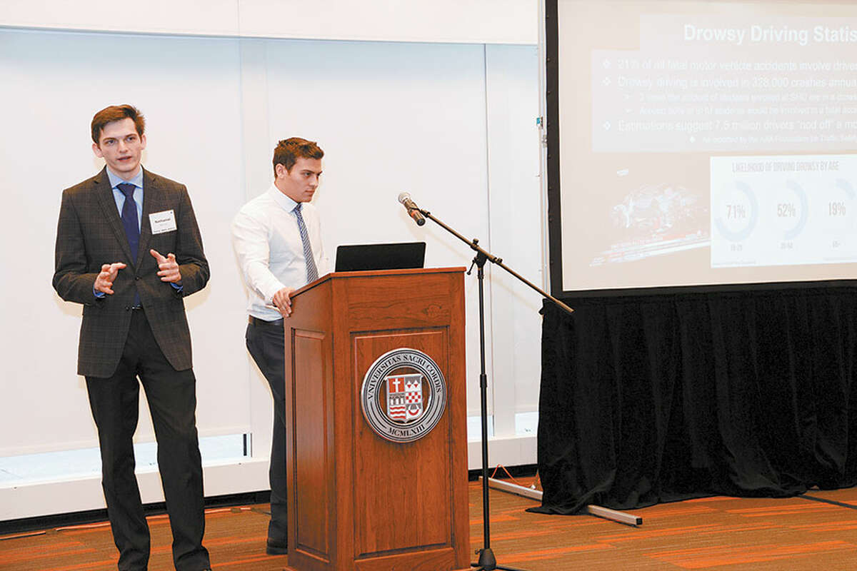 Nate Barone, left, and his teammate Frank Catania at the third annual College Tech Challenge. -SacredHeartUnivPix photo