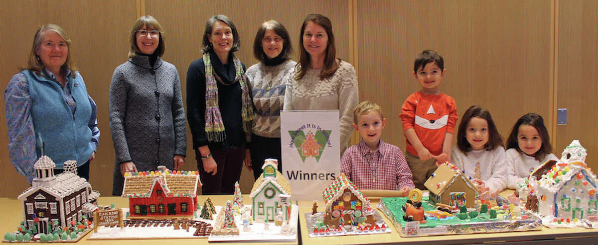 Winners of the How Sweet it is in Wilton! gingerbread house contest, from left, Tina Duncan, Allison Sanders, Kim Mellin, and Kelly Morron representing the Wilton Historical Society, Doris Noonan, Jack Deane, Amir Rahamim, Aurora Gulati and Winnie Gulati. - Janet Crystal photo