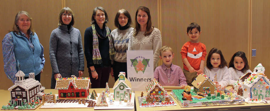 Winners of the How Sweet it is in Wilton! gingerbread house contest, from left, Tina Duncan, Allison Sanders, Kim Mellin, and Kelly Morron representing the Wilton Historical Society, Doris Noonan, Jack Deane, Amir Rahamim, Aurora Gulati and Winnie Gulati. — Janet Crystal photo