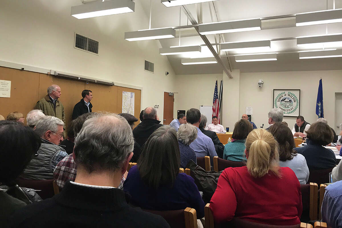 Room A of the town hall annex was standing- room-only for a public hearing on Millstone Property Holdings, LLC's application. - Kendra Baker photo