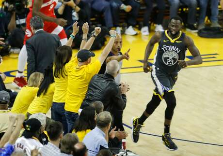 Golden State Warriors' Draymond Green turns in transition after hitting a three-pointer in the first quarter during game 6 of the NBA Finals between the Golden State Warriors and the Toronto Raptors at Oracle Arena on Thursday, June 13, 2019 in Oakland, Calif.