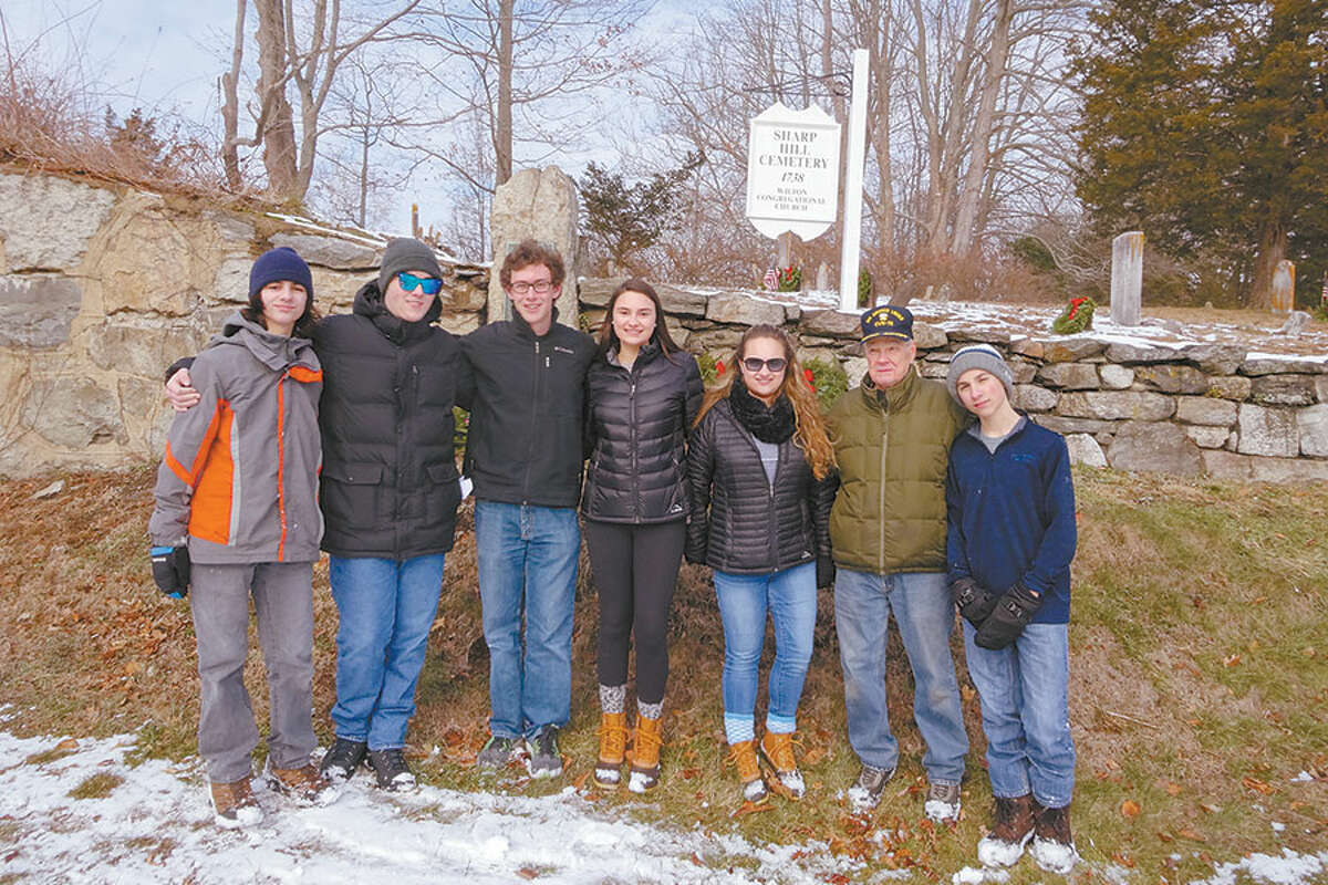 Participating in last year's Wreaths Across America ceremony are, from left, Julian Pojano, Dylan Pojano,Trevor Brown,Madison Amente, Alex Amente, an unidentified member of the public, and Logan Dzurilla. - Contributed photo