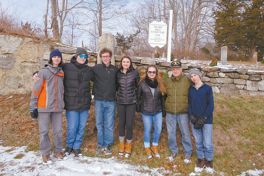 Participating in last year's Wreaths Across America ceremony are, from left, Julian Pojano, Dylan Pojano,Trevor Brown,Madison Amente, Alex Amente, an unidentified member of the public, and Logan Dzurilla. — Contributed photo