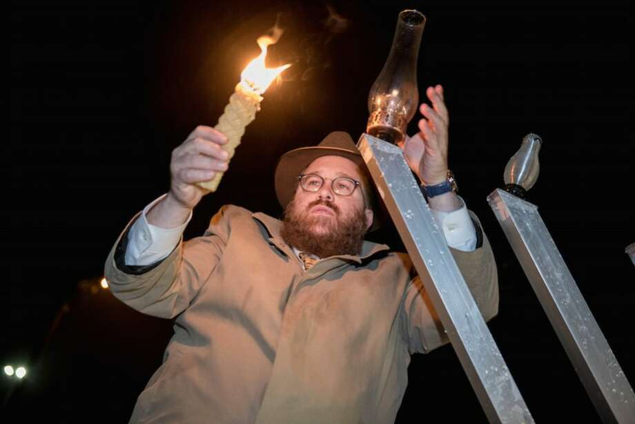 Rabbi Levi Stone of the Schneerson Center for Jewish Life lights the Menorah at Wilton Center on Dec. 3. Sunday was the first night of Hanukkah.