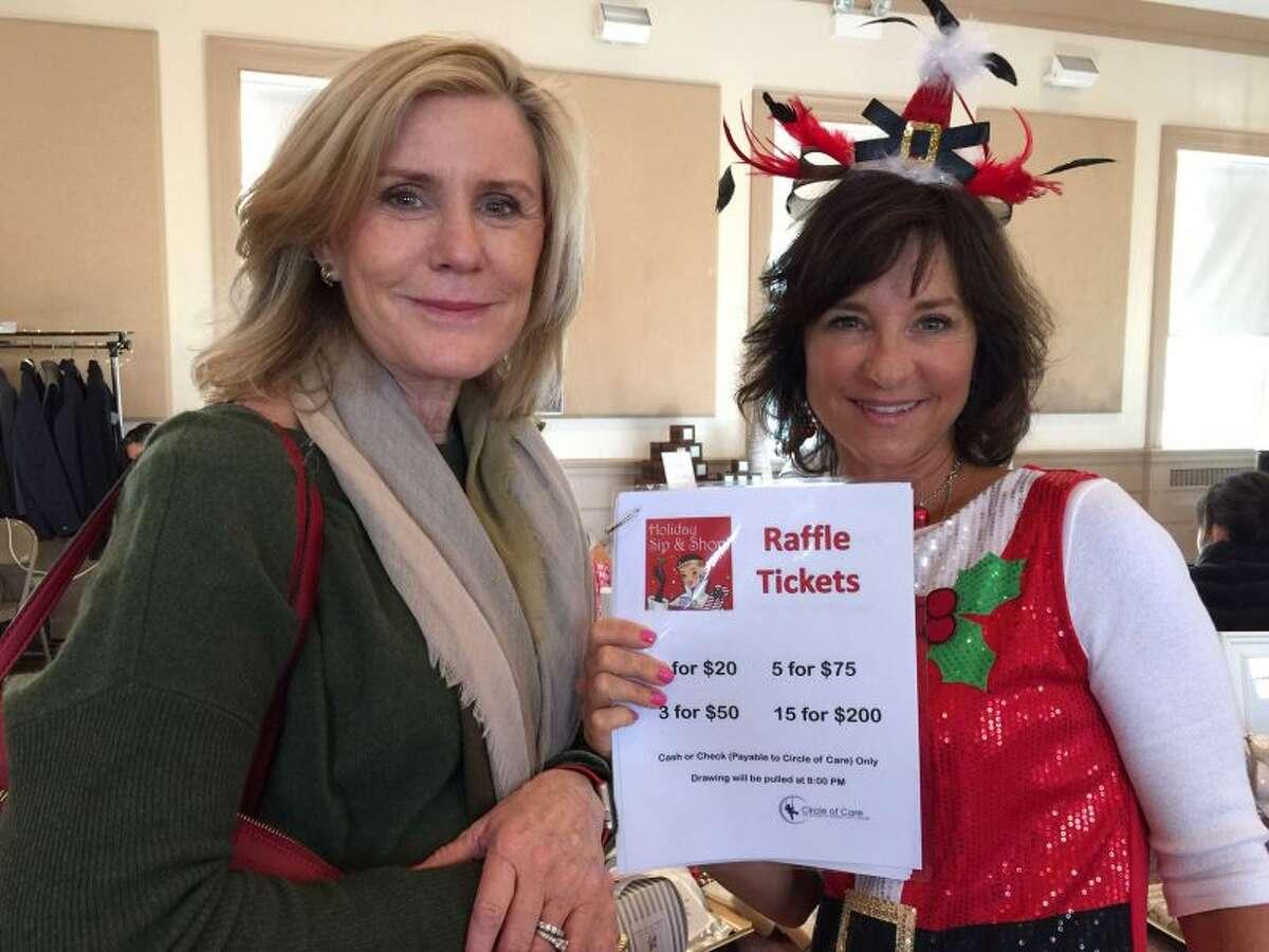 Jodi Meyer sells a raffle ticket to Muriel Rigby at Sip & Shop. - Patricia Gay photo