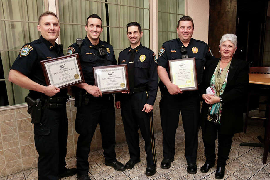 Wilton police officers Brandon Harris and Mark Canepari, Capt. Robert Cipolla, and Lt. David Hartman with AAA Public Affairs Manager Fran Mayko.